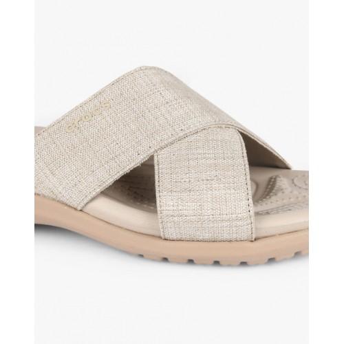 370061fef533 Buy Crocs Women Off-White Solid Open Toe Flats online