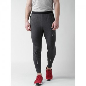 a4491430d21f Nike Men Charcoal Grey AS Dri-Fit Phenom Solid Running Joggers. ₹2401 ₹3695  Myntra. 35% off. Nike Grey Melange AS M NSW MODERN JOGGER FT ...