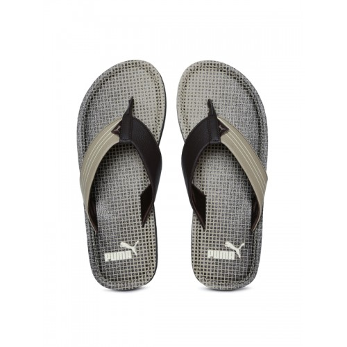 d1d956b0bb9ec2 Buy Puma Men Khaki   Black Solid Thong Flip-Flops online