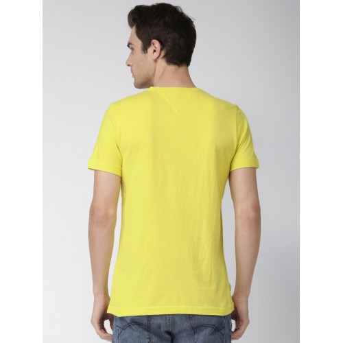88b16d45dc9bc Buy Tommy Hilfiger Men Yellow Solid Round Neck T-shirt online ...