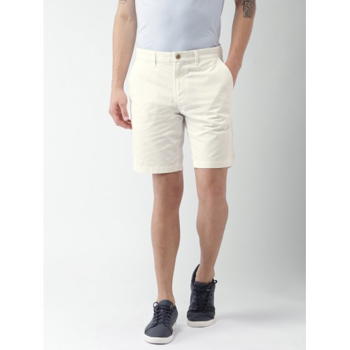 69c81efcc3 Buy Tommy Hilfiger White Cotton Solid Slim Fit Chino Shorts online ...