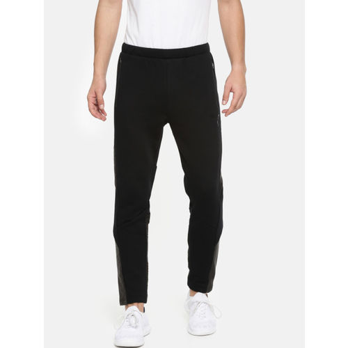 6e091acb40 Buy Puma Men Black Slim Fit Evostripe WR Solid Track Pants online ...