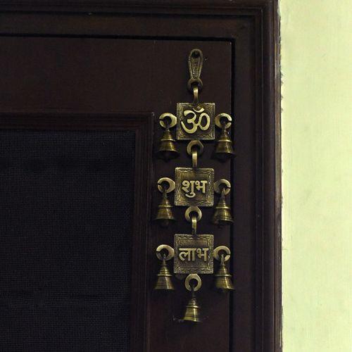 eCraftIndia Om Shubh Labh Brass Wall Hanging Bells Decorative Showpiece - 31 cm(Brass, Brown)