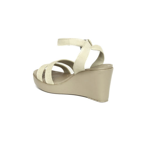660f4c00be8a0 Buy Crocs Women Beige Solid Leigh Wedges online