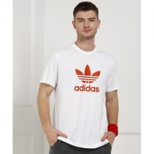 001bbae01 Buy Tommy Hilfiger Printed Men's Round Neck White T-Shirt online ...