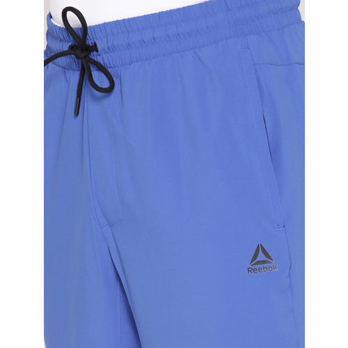 Reebok Men Blue Solid WOR Woven Training Track Pants