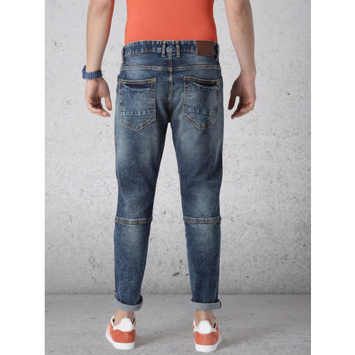 Ecko Unltd Men Blue Tapered Fit Mid-Rise Clean Look Stretchable Jeans