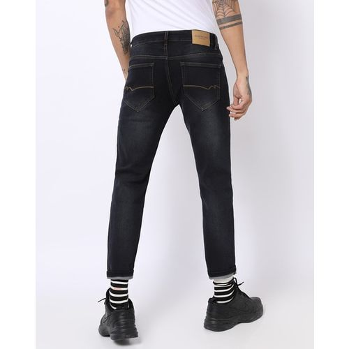 NUMERO UNO Low-Rise Tapered Jeans