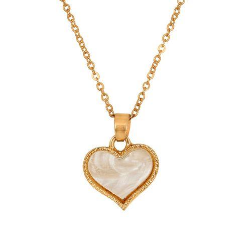 Fasherati gold metal pendant