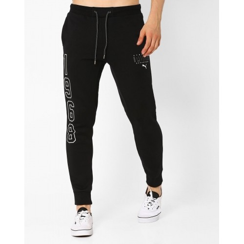 06e641bf1918 Buy Puma Black Cotton Solid Cuffed Athletic Track pants online ...