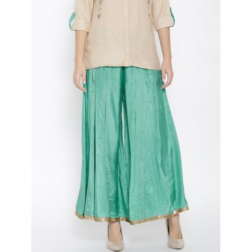 835222df1d0b6e Buy W Women Sea Green Printed Palazzo Trousers online   Looksgud.in