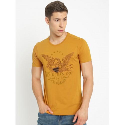0e046729af24 ... Arrow Blue Jean Co. Men Mustard Yellow Printed Polo Collar T-shirt ...